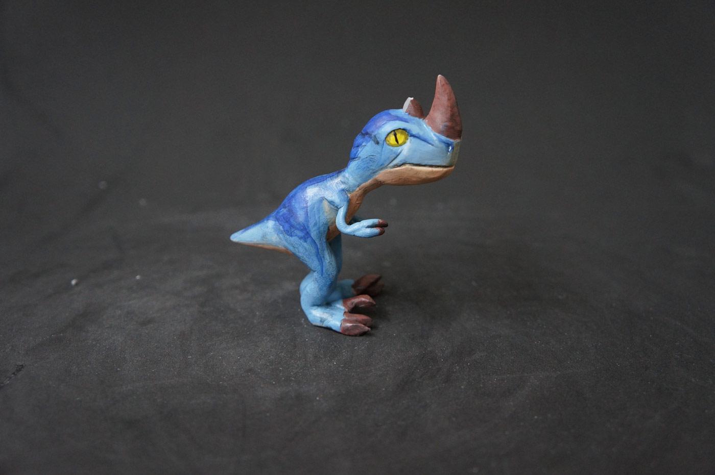 Sculpture du bébé raptor de Gundrak réalisée par Namow.